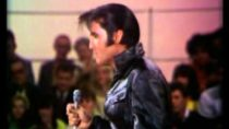 Elvis Presley wearing black leather suit singing – Heartbreak Hotel and All Shook Up