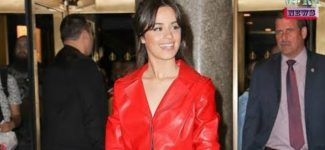 Camila Cabello in scarlet leather jumpsuit and boots