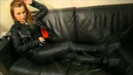 Rock chick posing in leather pants and classic leather biker jacket video